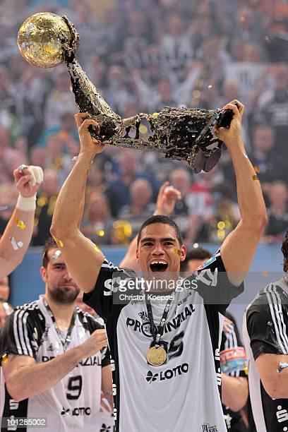 Daniel Narcisse of Kiel presents the handball champions league trophy after winning 3634 the handball final match between THW Kiel and FC Barcelona...