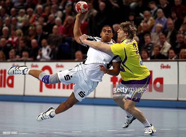 Daniel Narcisse of Kiel shoots at goal against Colja Loeffler of Berlin during the Toyota Handball Bundesliga match between THW Kiel and Fuechse...