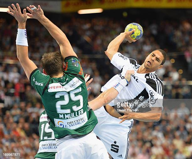 Daniel Narcisse of Kiel throws a goal during the Bundesliga match between THW Kiel and HSG Wetzlar at the Sparkasse Arena on June 5 2013 in Kiel...