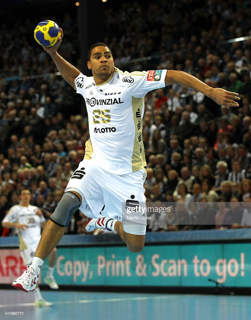 <a gi-track='captionPersonalityLinkClicked' href=/galleries/search?phrase=Daniel+Narcisse&family=editorial&specificpeople=791032 ng-click='$event.stopPropagation()'>Daniel Narcisse</a> of Kiel throws the ball during the EHF Champions League second leg match between THW Kiel and Orlen Wisla Plock at Sparkassen Arena on March 18, 2012 in Kiel, Germany.