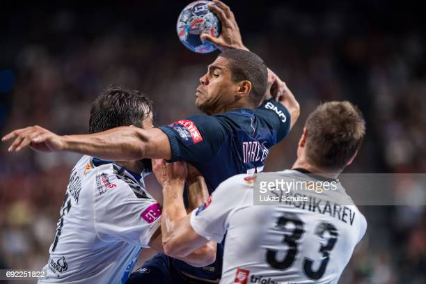 Daniel Narcisse of Paris is attacked by the defense of Vardar during the VELUX EHF FINAL4 Final match between Paris SaintGermain Handball and HC...