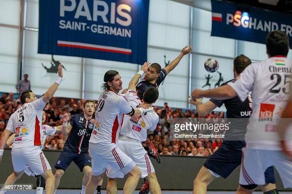 Daniel Narcisse of Paris SaintGermain Handball passes the ball from the back against Renato Sulic and Laszlo Nagy of MKBMVM Veszprem during the EHF...