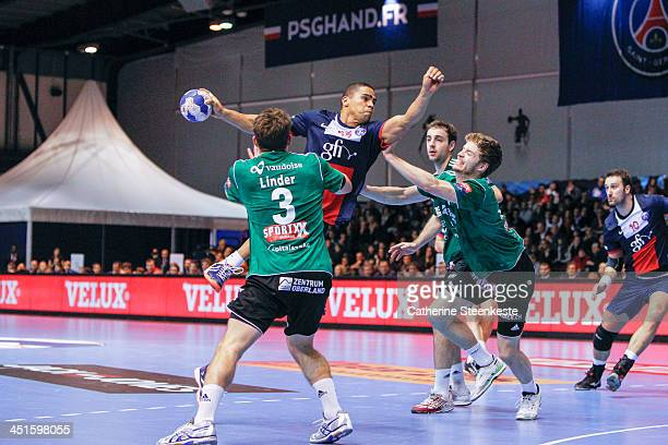 Daniel Narcisse of PSG Handball tries to shoot the ball against Luka Linder of Wacker Thun during the game PSG Handball v Wacker Thun at La Halle...