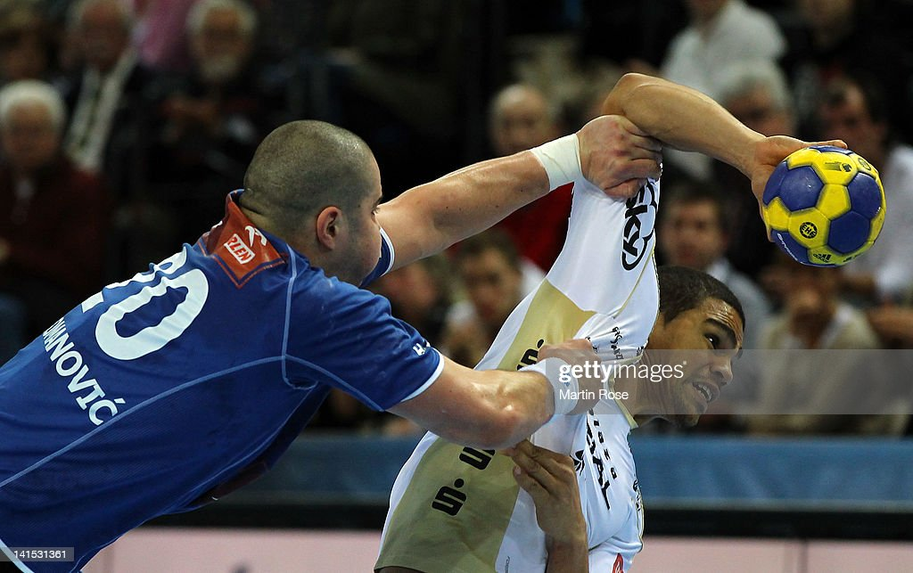 Daniel Narzisse (R) of Kiel is challenged Muhamed Toromanovic (L) of Plock during the EHF Champions League second leg match between THW Kiel and Orlen Wisla Plock at Sparkassen Arena on March 18, 2012 in Kiel, Germany.