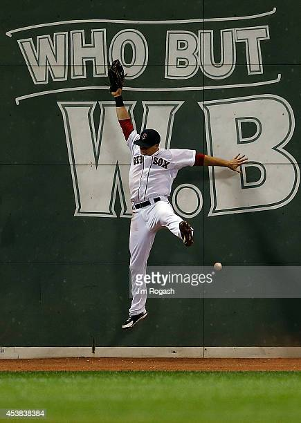 Daniel Nava of the Boston Red Sox cannot field a hit by Chris Iannetta of the Los Angeles Angels of Anaheim brining in the goahead run in the ninth...