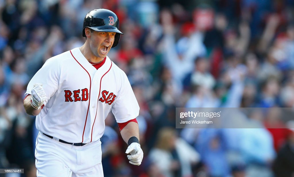 Daniel Nava #29 of the Boston Red Sox celebrates while trotting around first base after hitting a three-run home run in the seventh inning off of Wei-Yin Chen #16 of the Baltimore Orioles during the Opening Day game on April 8, 2013 at Fenway Park in Boston, Massachusetts.