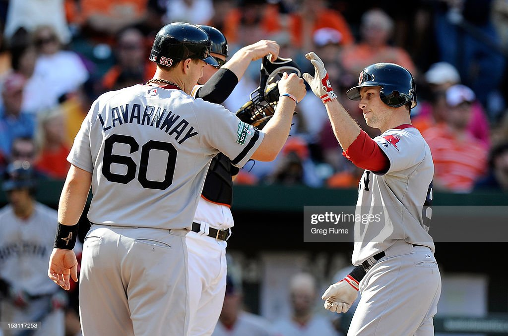 <a gi-track='captionPersonalityLinkClicked' href=/galleries/search?phrase=Daniel+Nava&family=editorial&specificpeople=670454 ng-click='$event.stopPropagation()'>Daniel Nava</a> #66 of the Boston Red Sox celebrates with Ryan Lavarnway #60 after hitting a home run in the seventh inning against the Baltimore Orioles at Oriole Park at Camden Yards on September 30, 2012 in Baltimore, Maryland.