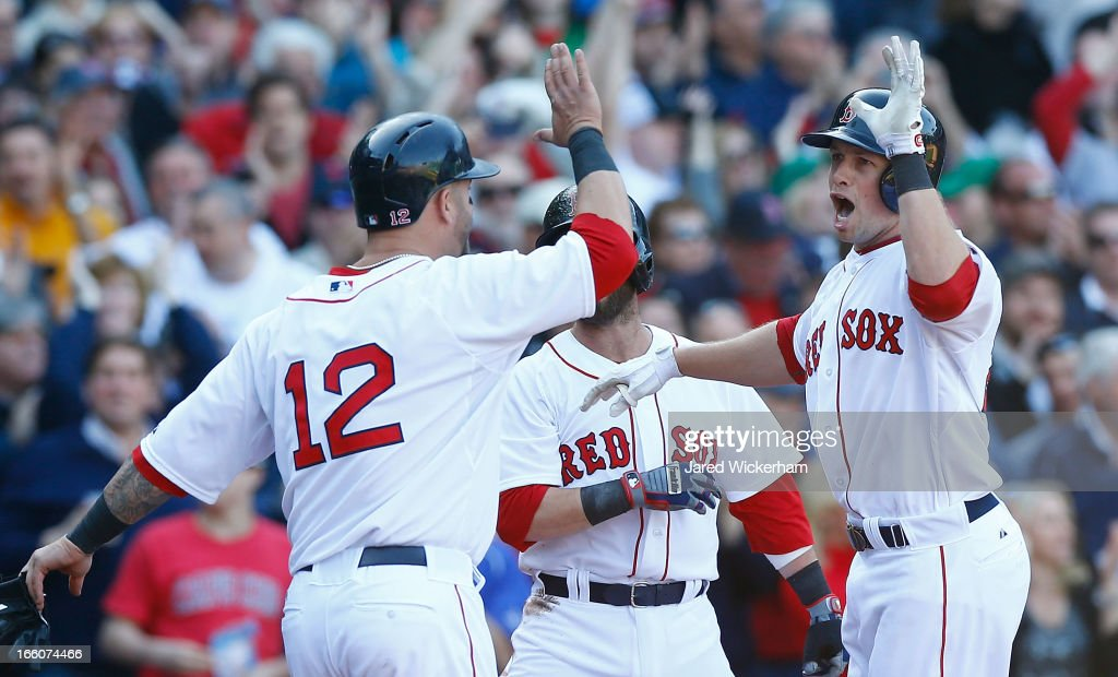 <a gi-track='captionPersonalityLinkClicked' href=/galleries/search?phrase=Daniel+Nava&family=editorial&specificpeople=670454 ng-click='$event.stopPropagation()'>Daniel Nava</a> #29 of the Boston Red Sox celebrates with teammate <a gi-track='captionPersonalityLinkClicked' href=/galleries/search?phrase=Mike+Napoli&family=editorial&specificpeople=525007 ng-click='$event.stopPropagation()'>Mike Napoli</a> #12 of the Boston Red Sox after hitting a three-run home run in the seventh inning off of Wei-Yin Chen #16 of the Baltimore Orioles during the Opening Day game on April 8, 2013 at Fenway Park in Boston, Massachusetts.
