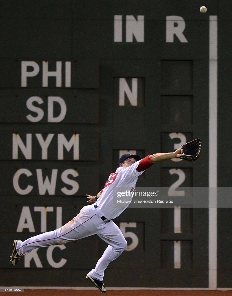 <a gi-track='captionPersonalityLinkClicked' href=/galleries/search?phrase=Daniel+Nava&family=editorial&specificpeople=670454 ng-click='$event.stopPropagation()'>Daniel Nava</a> #29 of the Boston Red Sox dives but cannot catch a fly ball off the bat of Carlos Gonzalez #5 of the Colorado Rockies in the seventh inning on June 25, 2013 at Fenway Park in Boston, Massachusetts.