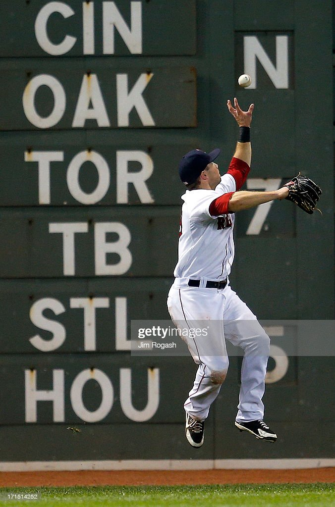 <a gi-track='captionPersonalityLinkClicked' href=/galleries/search?phrase=Daniel+Nava&family=editorial&specificpeople=670454 ng-click='$event.stopPropagation()'>Daniel Nava</a> #29 of the Boston Red Sox grabs the ball off of the wall to hold batter Nolan Arenado #28 of the Colorado Rockies to a single in the 5th inning at Fenway Park on June 25, 2013 in Boston, Massachusetts.