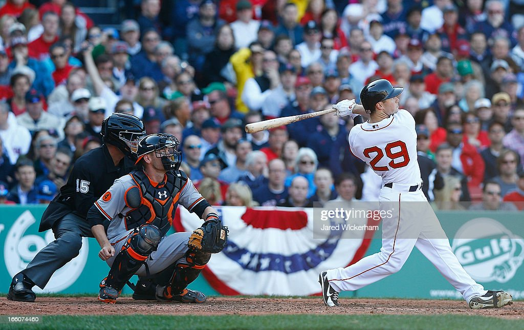 <a gi-track='captionPersonalityLinkClicked' href=/galleries/search?phrase=Daniel+Nava&family=editorial&specificpeople=670454 ng-click='$event.stopPropagation()'>Daniel Nava</a> #29 of the Boston Red Sox hits a three-run home run in the seventh inning off of Wei-Yin Chen #16 of the Baltimore Orioles during the Opening Day game on April 8, 2013 at Fenway Park in Boston, Massachusetts.