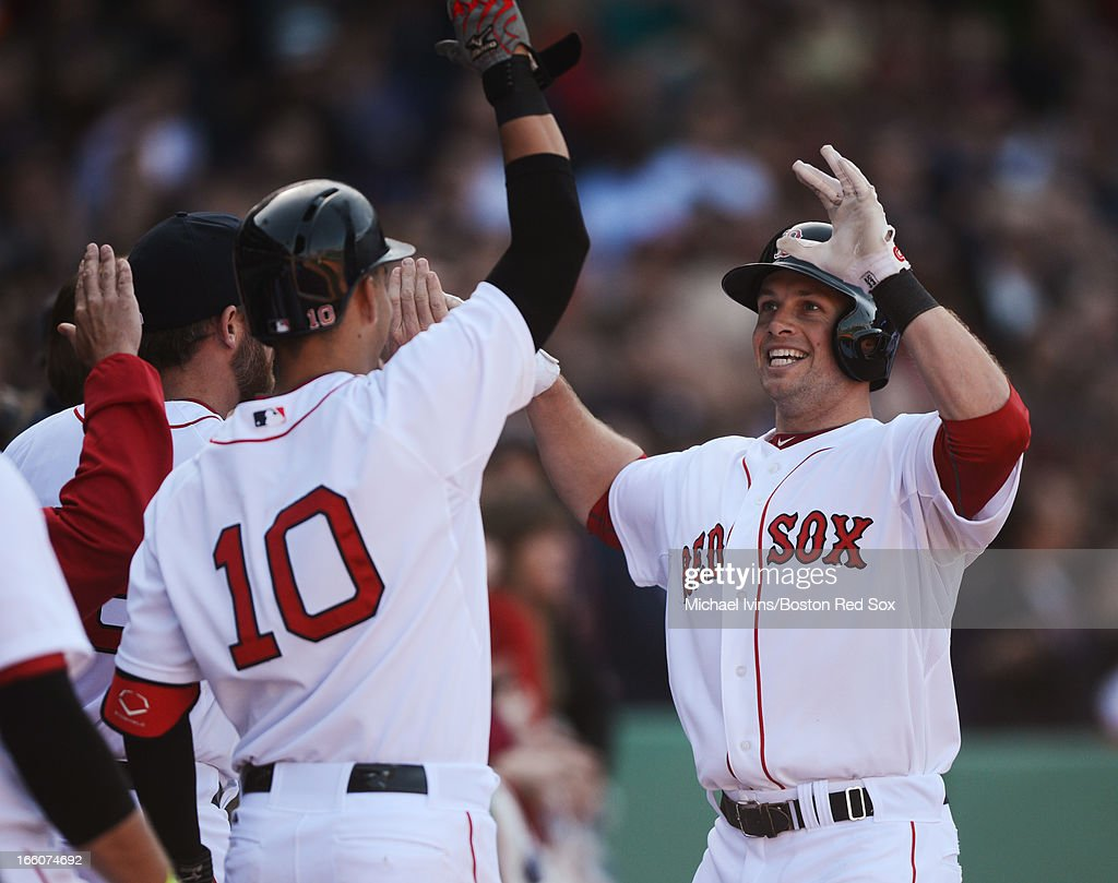 <a gi-track='captionPersonalityLinkClicked' href=/galleries/search?phrase=Daniel+Nava&family=editorial&specificpeople=670454 ng-click='$event.stopPropagation()'>Daniel Nava</a> #29 of the Boston Red Sox is greeted by teammates at the dugout after hitting a three-run home run against the Baltimore Orioles in the seventh inning on April 8, 2013 at Fenway Park in Boston, Massachusetts.