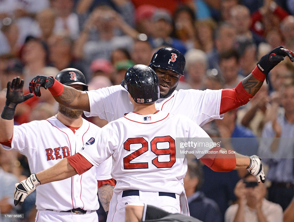<a gi-track='captionPersonalityLinkClicked' href=/galleries/search?phrase=Daniel+Nava&family=editorial&specificpeople=670454 ng-click='$event.stopPropagation()'>Daniel Nava</a> #29 of the Boston Red Sox is hugged by <a gi-track='captionPersonalityLinkClicked' href=/galleries/search?phrase=David+Ortiz&family=editorial&specificpeople=175825 ng-click='$event.stopPropagation()'>David Ortiz</a> #34 after hitting a home run against the Detroit Tigers during the seventh inning on September 4, 2013 at Fenway Park in Boston Massachusetts.