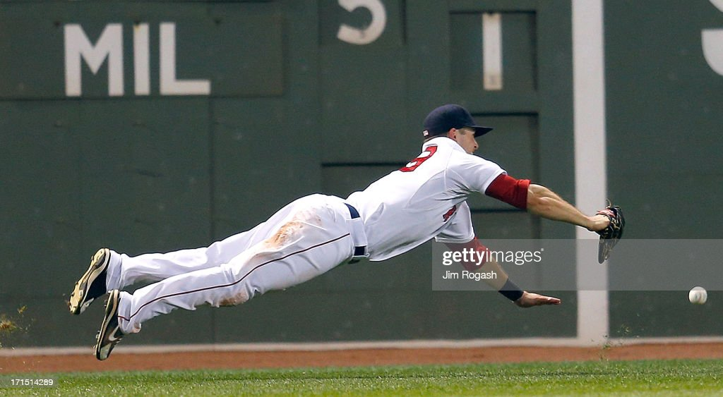 <a gi-track='captionPersonalityLinkClicked' href=/galleries/search?phrase=Daniel+Nava&family=editorial&specificpeople=670454 ng-click='$event.stopPropagation()'>Daniel Nava</a> #29 of the Boston Red Sox is unable to grab a ball hit by Carlos Gonzalez #5 of the Colorado Rockiese in the 7th inning at Fenway Park on June 25, 2013 in Boston, Massachusetts.