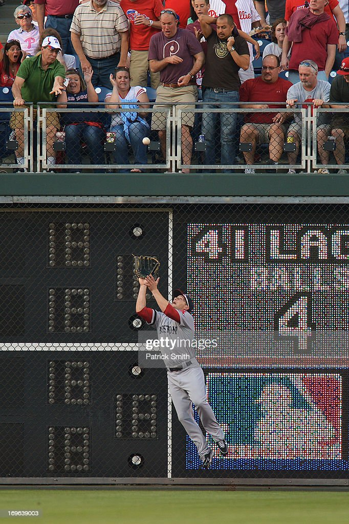 <a gi-track='captionPersonalityLinkClicked' href=/galleries/search?phrase=Daniel+Nava&family=editorial&specificpeople=670454 ng-click='$event.stopPropagation()'>Daniel Nava</a> #29 of the Boston Red Sox jumps to catch a deep fly ball hit by Erik Kratz #31 of the Philadelphia Phillies in the second inning at Citizens Bank Park on May 29, 2013 in Philadelphia, Pennsylvania.