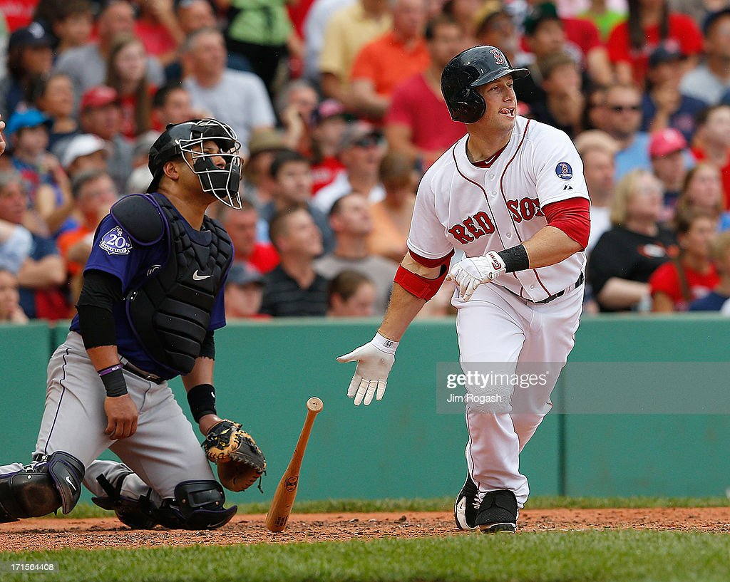 Daniel Nava #29 of the Boston Red Sox knocks in a run against the Colorado Rockies in the 3rd inning at Fenway Park on June 26, 2013 in Boston, Massachusetts.