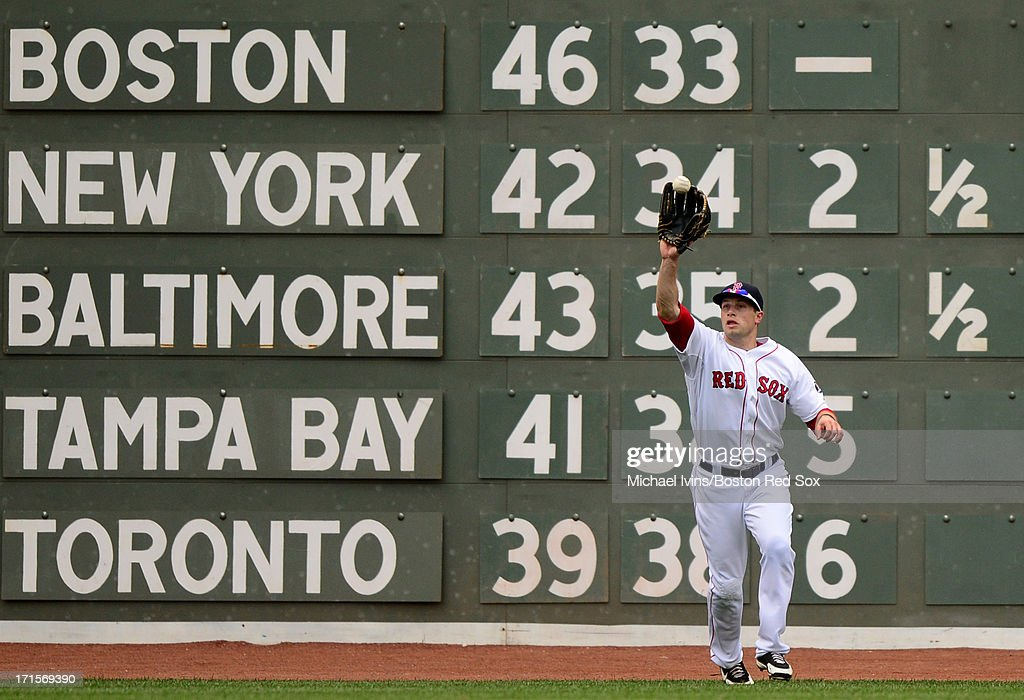 Daniel Nava #29 of the Boston Red Sox makes a catch against the Colorado Rockies in the sixth inning on June 26, 2013 at Fenway Park in Boston, Massachusetts.