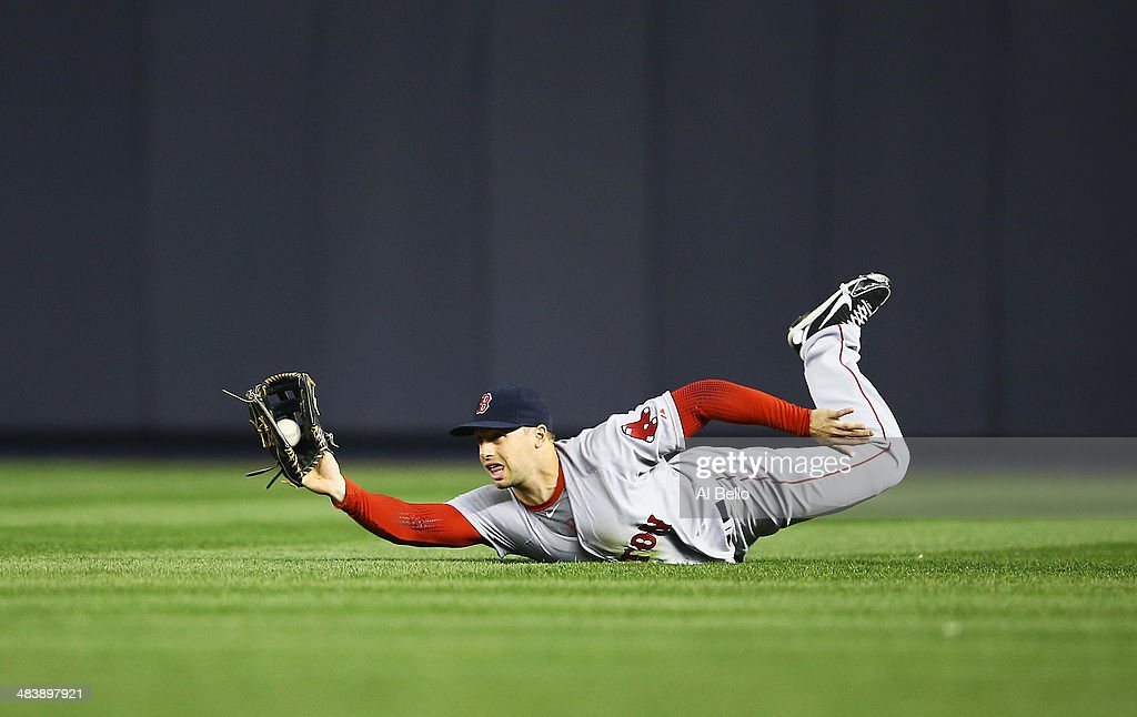 Daniel Nava #29 of the Boston Red Sox makes a catch hit by Yangervis Solarte #26 of the New York Yankees during their game at Yankee Stadium on April 10, 2014 in the Bronx borough of New York City.