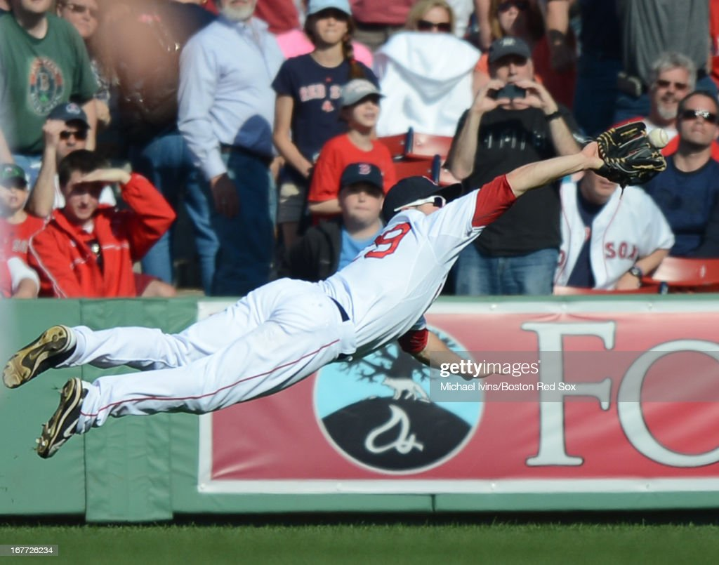 <a gi-track='captionPersonalityLinkClicked' href=/galleries/search?phrase=Daniel+Nava&family=editorial&specificpeople=670454 ng-click='$event.stopPropagation()'>Daniel Nava</a> #29 of the Boston Red Sox makes a diving catch against the Houston Astros in the ninth inning on April 28, 2013 at Fenway Park in Boston, Massachusetts.