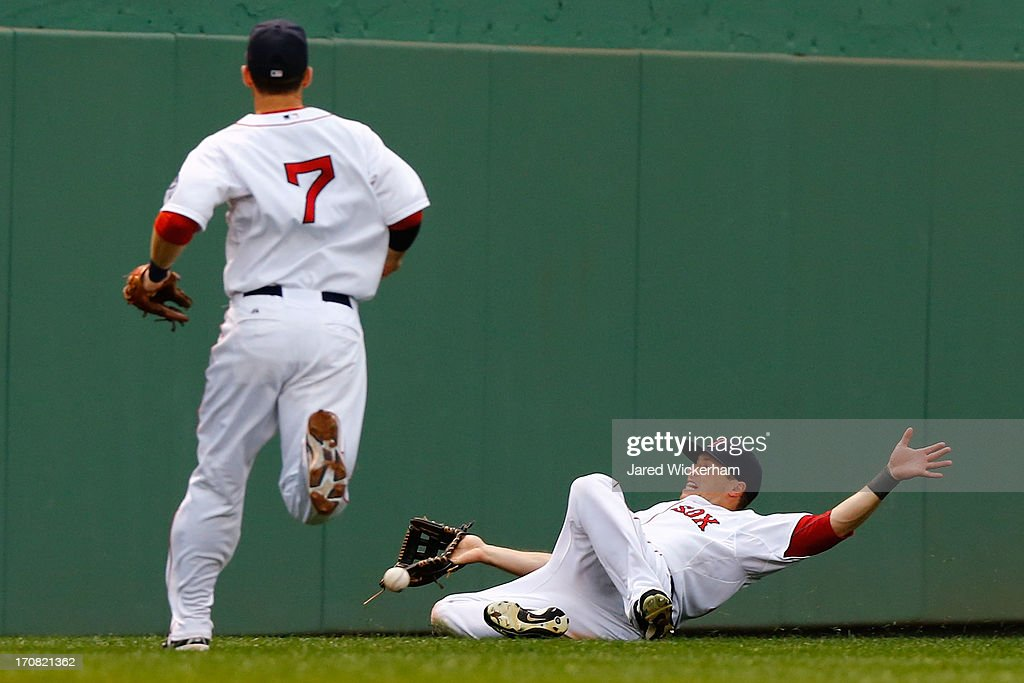 Daniel Nava #29 of the Boston Red Sox slides but fails to come up with a catch in left field against the Tampa Bay Rays during the game on June 18, 2013 at Fenway Park in Boston, Massachusetts.