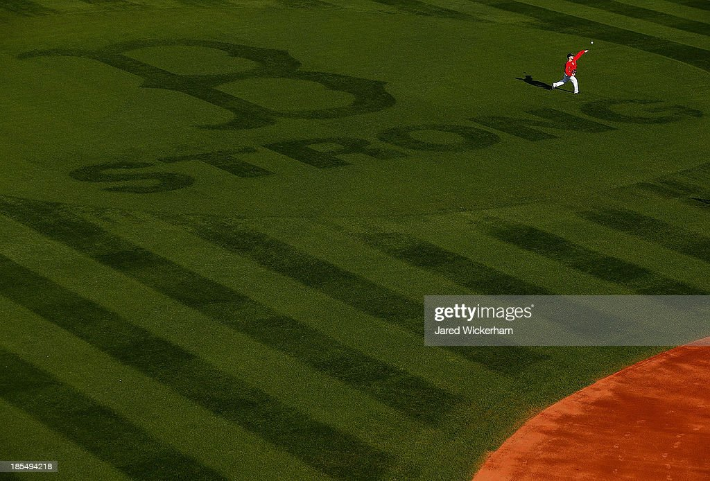 <a gi-track='captionPersonalityLinkClicked' href=/galleries/search?phrase=Daniel+Nava&family=editorial&specificpeople=670454 ng-click='$event.stopPropagation()'>Daniel Nava</a> #29 of the Boston Red Sox throws in center field during the workout prior to the start of the World Series on October 21, 2013 at Fenway Park in Boston, Massachusetts.