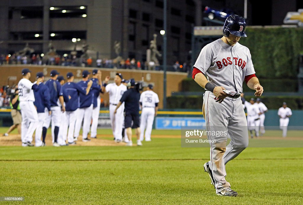 <a gi-track='captionPersonalityLinkClicked' href=/galleries/search?phrase=Daniel+Nava&family=editorial&specificpeople=670454 ng-click='$event.stopPropagation()'>Daniel Nava</a> #29 of the Boston Red Sox walks off the field as the Detroit Tigers celebrate a 8-6 win at Comerica Park on June 7, 2014 in Detroit, Michigan.