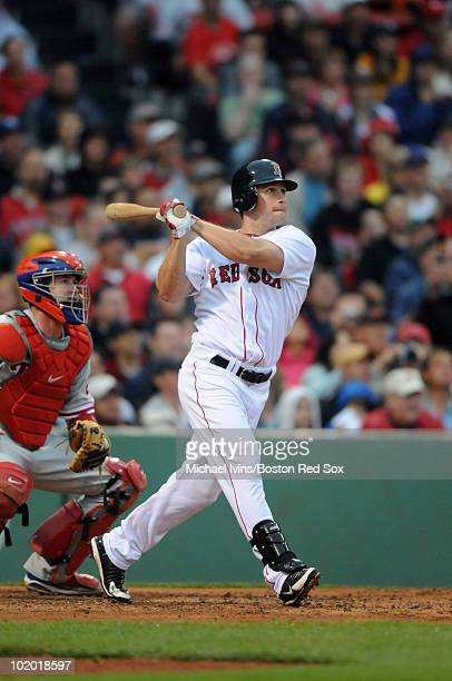 Daniel Nava of the Boston Red Sox watches the flight of his grand slam home run in front of Brian Schneider of the Philadelphia Phillies in the...