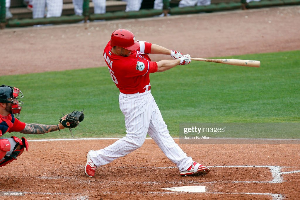 Daniel Nava #25 of the Philadelphia Phillies hits a triple to deep center in the second inning against the Boston Red Sox during a spring training game at Spectrum Field on March 12, 2017 in Clearwater, Florida.