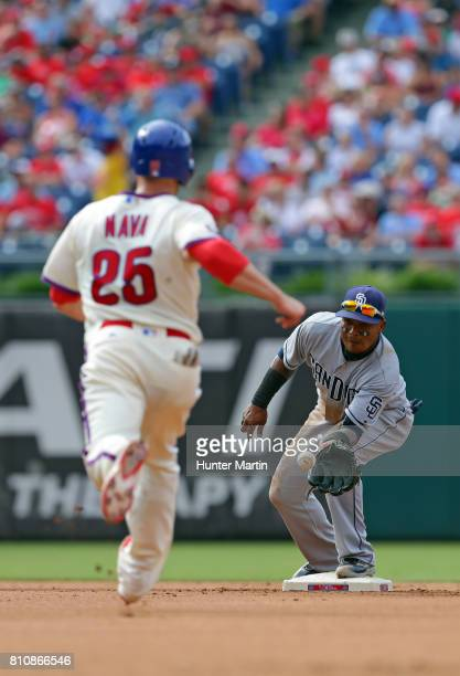 Daniel Nava of the Philadelphia Phillies is thrown out at second base as Erick Aybar of the San Diego Padres catches the throw in the fourth inning...