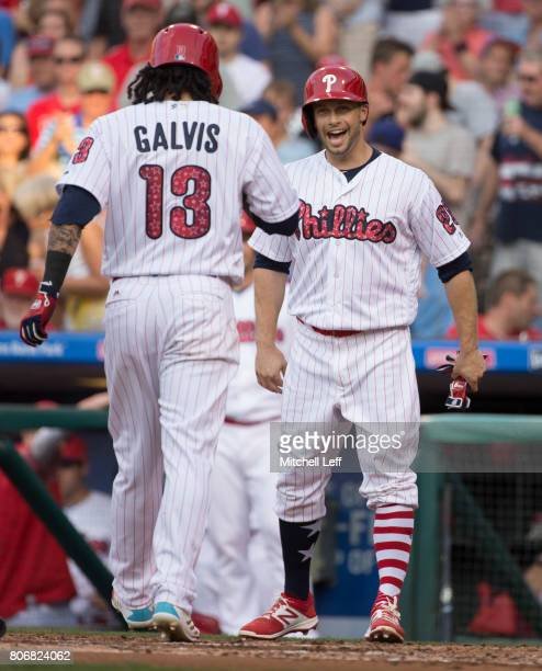 Daniel Nava of the Philadelphia Phillies reacts after a tworun home run off the at of Freddy Galvis of the Philadelphia Phillies in the bottom of the...