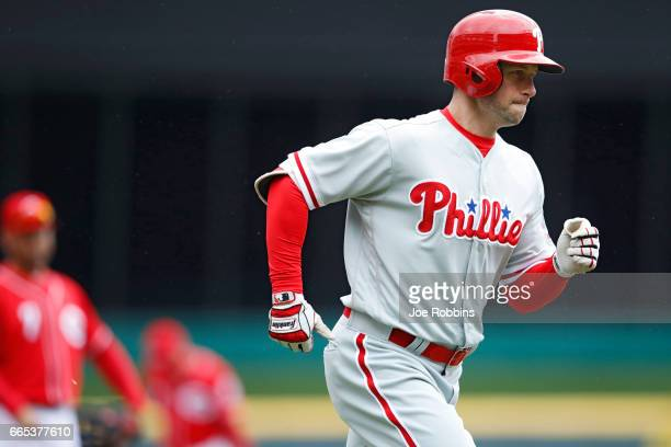 Daniel Nava of the Philadelphia Phillies rounds the bases after a solo home run in the first inning of the game against the Cincinnati Reds at Great...