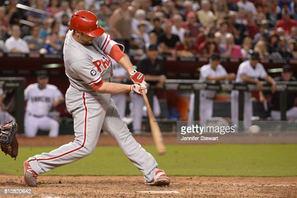 Daniel Nava of the Philadelphia Phillies swings at a pitch against the Arizona Diamondbacks at Chase Field on June 23 2017 in Phoenix Arizona The...