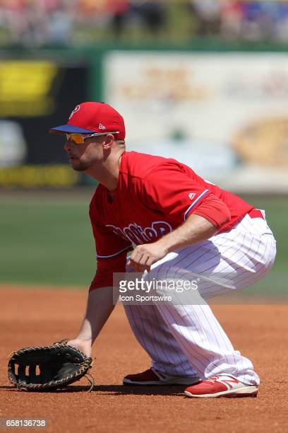 Daniel Nava of the Phillies is down and set at first base during the spring training game between the Pittsburgh Pirates and the Philadelphia...