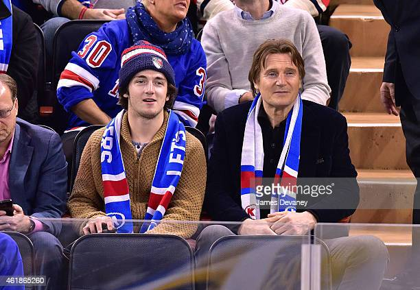 Daniel Neeson and Liam Neeson attend Ottawa Senators vs New York Rangers game at Madison Square Garden on January 20 2015 in New York City