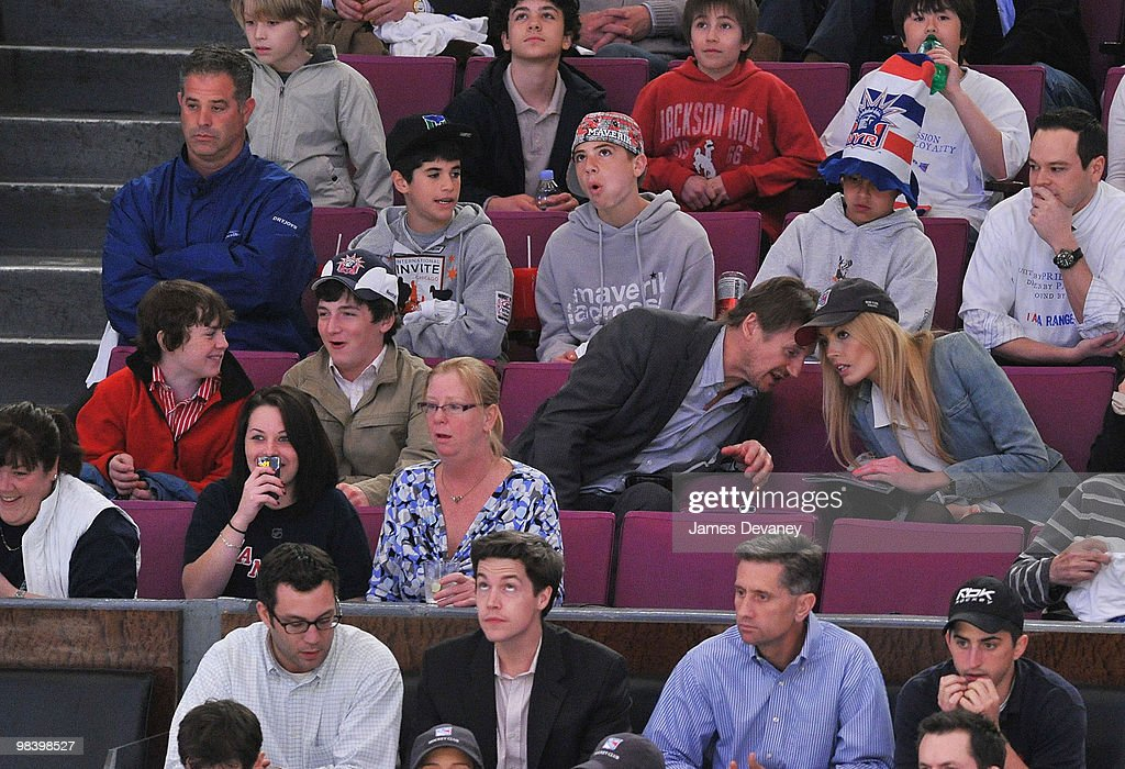 Daniel Neeson, Michael Neeson, Liam Neeson and Jennifer Ohlsson attend a game between the Philadelphia Flyers and the New York Rangers at Madison Square Garden on April 9, 2010 in New York City.