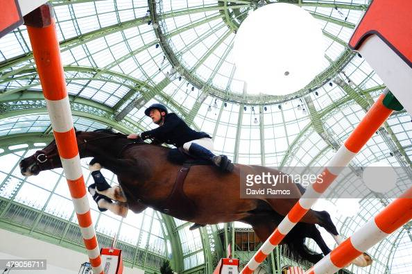 Daniel Neilson of Great Britain on Coco Bongo in action to finish second of the Prix de la Ville de Paris during the third day of the Grand Prix...