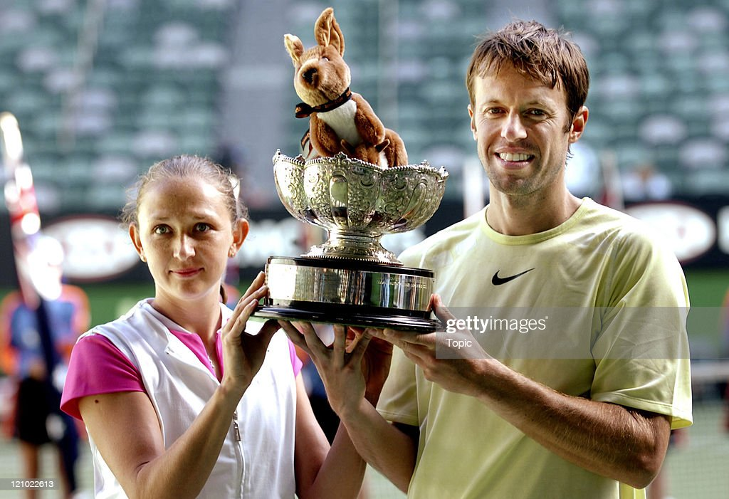 <a gi-track='captionPersonalityLinkClicked' href=/galleries/search?phrase=Daniel+Nestor&family=editorial&specificpeople=212827 ng-click='$event.stopPropagation()'>Daniel Nestor</a> and Elena Likhovtseva hold the Mixed Doubles winners trophy at the 2007 Australian Open at Rod Laver Arena, Melbourne, Australia, January 28, 2007.