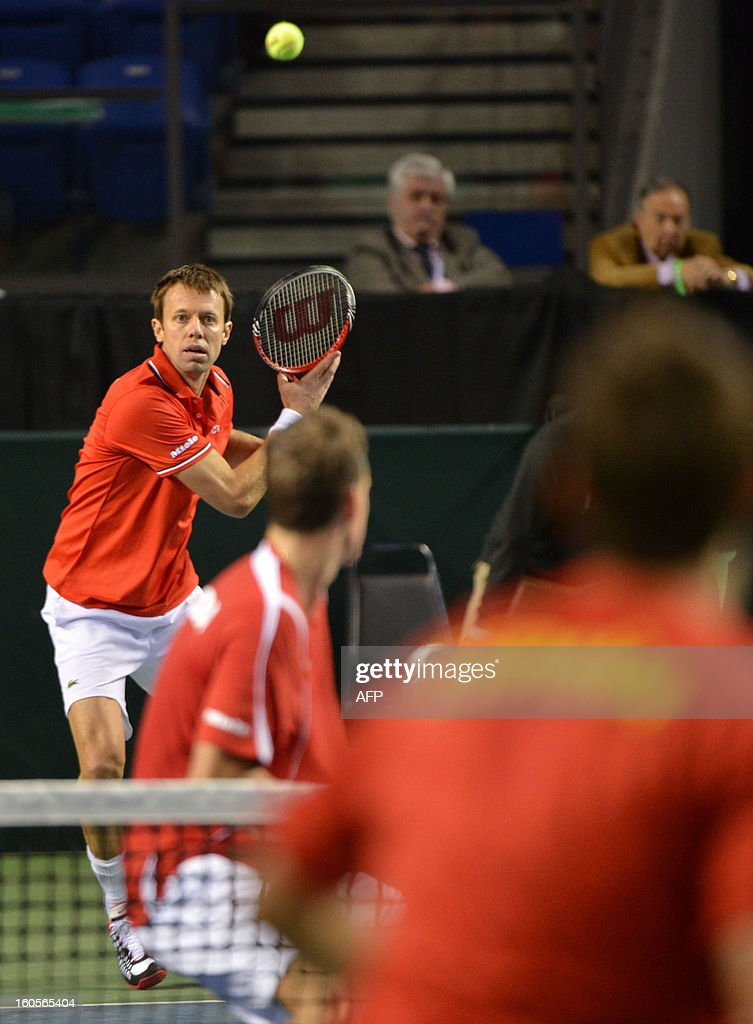 Daniel Nestor (L) and Vasek Pospisil (C) of Canada play against Marc Lopez and Marcel Granollers during a Davis Cup World Group Doubles Rubber, February 2, 2013, at the Doug Mitchell Thunderbird Sports Centre, in Vancouver, BC. AFP PHOTO / Don MACKINNON