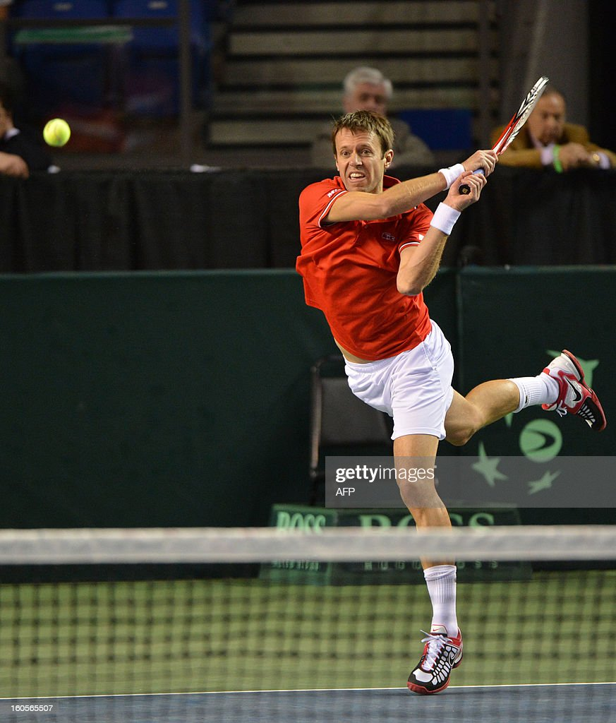 Daniel Nestor and Vasek Pospisil (not pictured) of Canada play against Marc Lopez and Marcel Granollers (both not pictured) of Spain during a Davis Cup World Group Doubles Rubber, February 2, 2013, at the Doug Mitchell Thunderbird Sports Centre, in Vancouver, BC. AFP PHOTO / Don MACKINNON