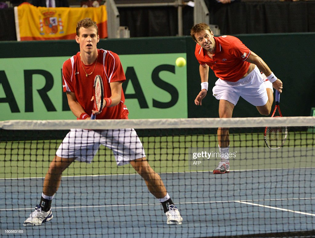 Daniel Nestor (R) and Vasek Pospisil (L) of Canada play against Marcel Granollers and Marc Lopez (both not pictured) of Spain during a Davis Cup World Group Doubles Rubber, February 2, 2013, at the Doug Mitchell Thunderbird Sports Centre, in Vancouver, BC. AFP PHOTO / Don MACKINNON