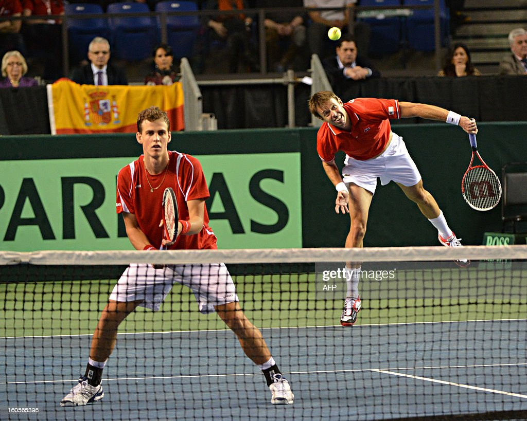 Daniel Nestor(R) and Vasek Pospisil (L) of Canada play against Marcel Granollers and Marc Lopez (both not pictured) of Spain during a Davis Cup World Group Doubles Rubber, February 2, 2013, at the Doug Mitchell Thunderbird Sports Centre, in Vancouver, BC. AFP PHOTO / Don MACKINNON