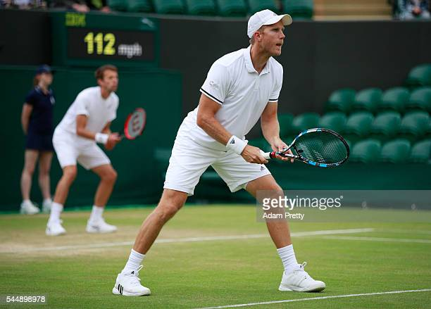 Daniel Nestor of Canada and Domonic Inglot of Great Britain in action during the Men's doubles third round match against Juluen Benneteau of France...
