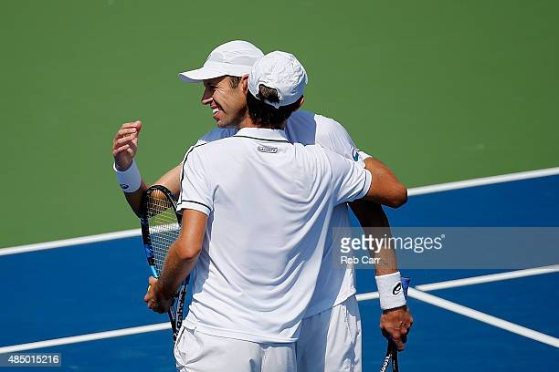 Daniel Nestor of Canada and Edouard RogerVasselin of France celebrate match point after defeating Marcin Matkowski of Poland and Nenad Zimonjic of...