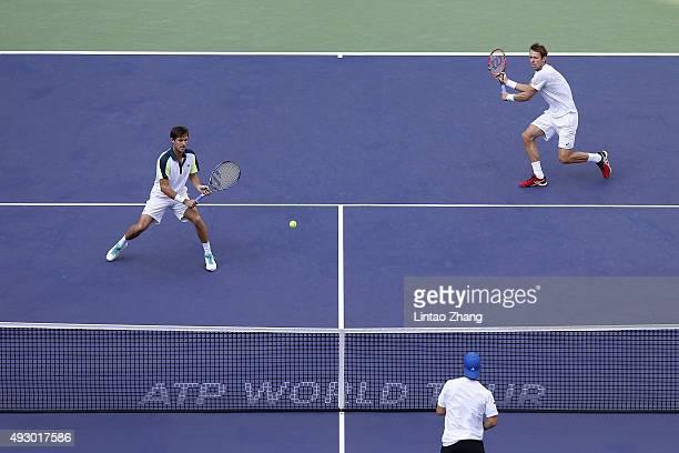 Daniel Nestor of Canada and Edouard RogerVasselin of France returns a shot against Simone Bolelli and Fabio Fognini of Italy during their men's...