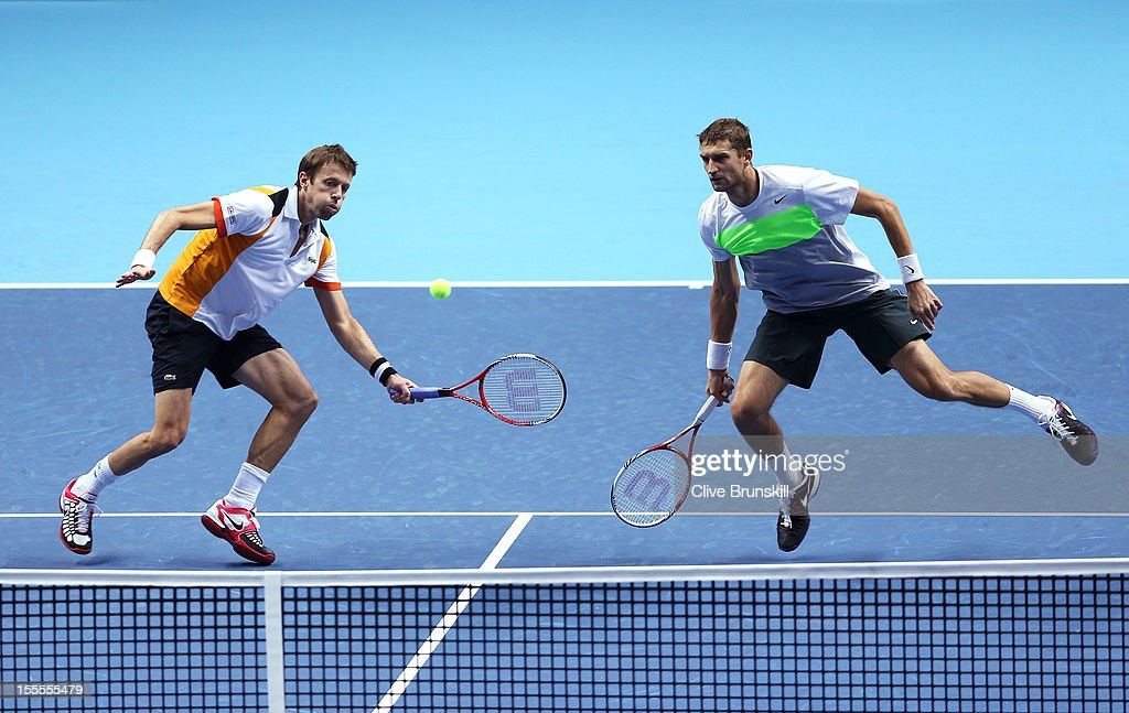 Daniel Nestor of Canada and Max Mirnyi of Belarus in action during the men's doubles match against Robert Lindstedt of Sweden and Horia Tecau of Romania on day one of the ATP World Tour Finals at the O2 Arena on November 5, 2012 in London, England.
