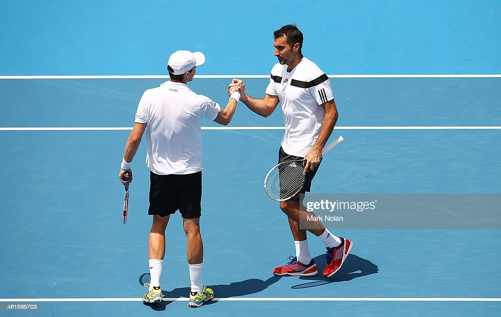 Daniel Nestor of Canada and Nenad Zimonjic of Serbia celebrate winnning their doubles match against Julien Benneteau and Edouard Roger-Vasselin of France during day five of the 2014 Sydney International at Sydney Olympic Park Tennis Centre on January 9, 2014 in Sydney, Australia.