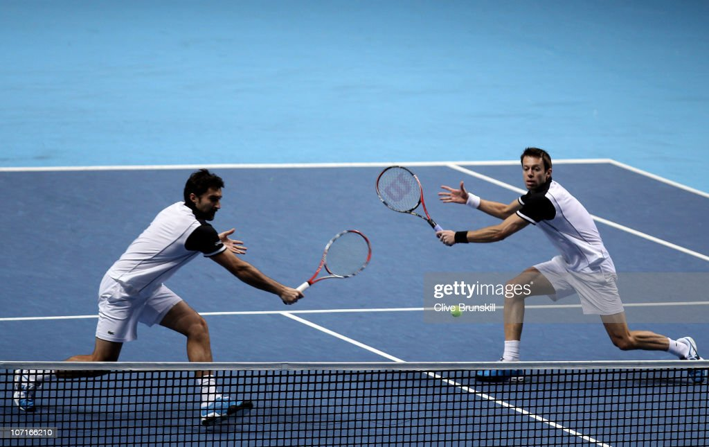 <a gi-track='captionPersonalityLinkClicked' href=/galleries/search?phrase=Daniel+Nestor&family=editorial&specificpeople=212827 ng-click='$event.stopPropagation()'>Daniel Nestor</a> of Canada (R) and <a gi-track='captionPersonalityLinkClicked' href=/galleries/search?phrase=Nenad+Zimonjic&family=editorial&specificpeople=243242 ng-click='$event.stopPropagation()'>Nenad Zimonjic</a> of Serbia (L) eye the ball during their men's double semi-final match against Mike Bryan and Bob Bryan of the USA during ATP World Tour Finals at O2 Arena on November 27, 2010 in London, England.