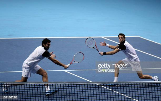 Daniel Nestor of Canada and Nenad Zimonjic of Serbia eye the ball during their men's double semifinal match against Mike Bryan and Bob Bryan of the...