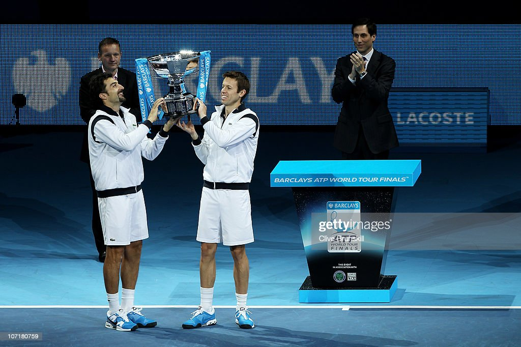 <a gi-track='captionPersonalityLinkClicked' href=/galleries/search?phrase=Daniel+Nestor&family=editorial&specificpeople=212827 ng-click='$event.stopPropagation()'>Daniel Nestor</a> of Canada (Front R) and <a gi-track='captionPersonalityLinkClicked' href=/galleries/search?phrase=Nenad+Zimonjic&family=editorial&specificpeople=243242 ng-click='$event.stopPropagation()'>Nenad Zimonjic</a> of Serbia (Front L) hold the trophy, presented by CE of Barclays Global Retail Banking Antony Jenkins (Back L) and ATP Exectutive Chairman & President Adam Helfant, as they celebrate winning the men's doubles final match against Mahesh Bhupathi of India and Max Mirnyi of Belarus during the ATP World Tour Finals at O2 Arena on November 28, 2010 in London, England.