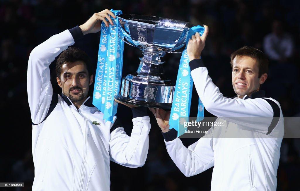 <a gi-track='captionPersonalityLinkClicked' href=/galleries/search?phrase=Daniel+Nestor&family=editorial&specificpeople=212827 ng-click='$event.stopPropagation()'>Daniel Nestor</a> of Canada (R) and <a gi-track='captionPersonalityLinkClicked' href=/galleries/search?phrase=Nenad+Zimonjic&family=editorial&specificpeople=243242 ng-click='$event.stopPropagation()'>Nenad Zimonjic</a> of Serbia (L) hold the trophy as they celebrate winning the men's doubles final match against Mahesh Bhupathi of India and Max Mirnyi of Belarus during the ATP World Tour Finals at O2 Arena on November 28, 2010 in London, England.